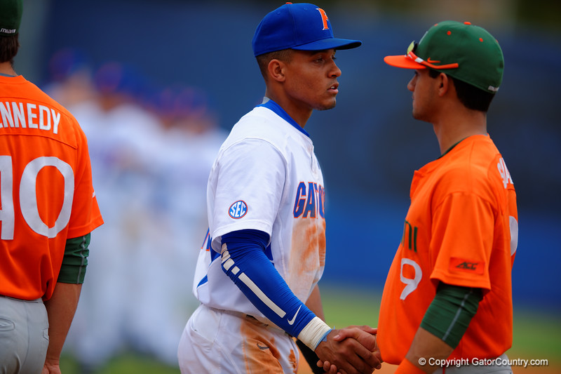 Florida Gators shortstop Richie Martin shakes hands with the Miami Hurricanes following their 2-1 win over the Canes.  Florida Gators vs Miami Hurricanes.  February 22nd, 2015. Gator Country photo by David Bowie.