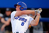 Florida Gators outfielder Harrison Bader drives the ball deep for the first Gator home run of the night.  Florida Gators Baseball vs South Carolina Gamecocks.  April 10th, 2015. Gator Country photo by David Bowie.