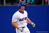 Florida Gators outfielder Harrison Bader runs to the dugout after hitting a home run in the first inning.  Florida Gators Baseball vs South Carolina Gamecocks.  April 10th, 2015. Gator Country photo by David Bowie.