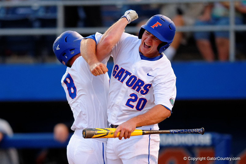 Florida Gators infielder Peter Alonso congratulates Florida Gators outfielder Harrison Bader as he crosses home after hitting a home run in the first inning.  Florida Gators Baseball vs South Carolina Gamecocks.  April 10th, 2015. Gator Country photo by David Bowie.