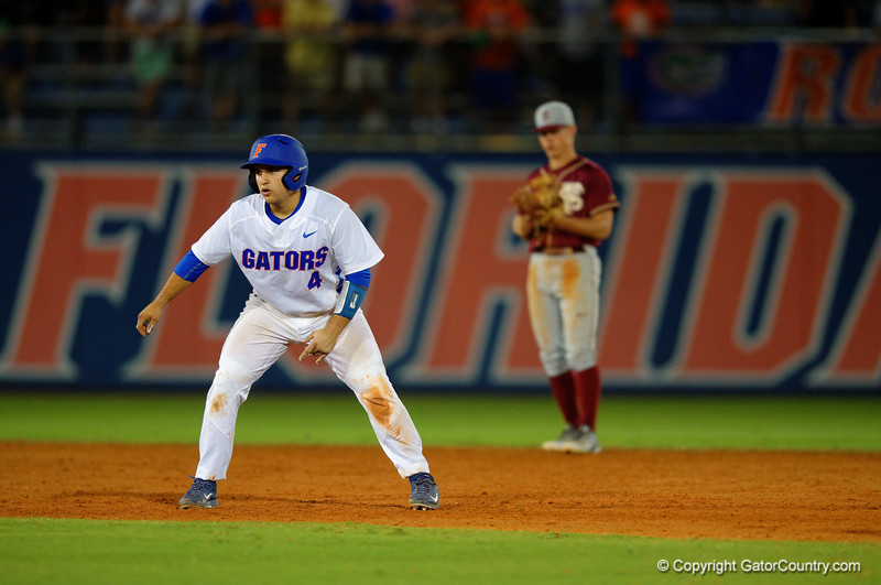 Florida Gators catcher Mike Rivera doubles in the fifth inning.  Florida Gators Baseball vs Florida State Seminoles.  March 17th, 2016. Gator Country photo by David Bowie.