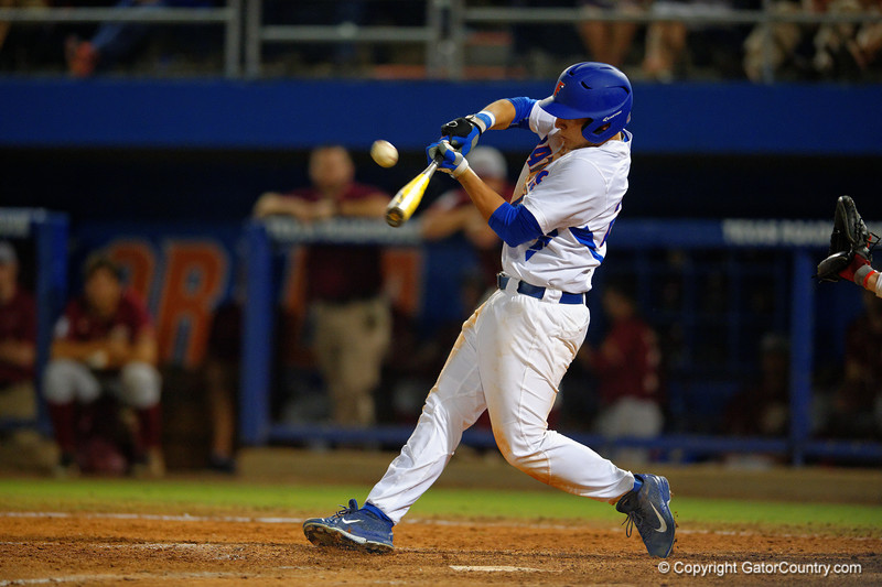 Florida Gators 1B/OF Jeremy Vasquez swings at a pitch in the sixth.  Florida Gators Baseball vs Florida State Seminoles.  March 17th, 2016. Gator Country photo by David Bowie.