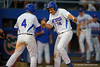 Florida Gators infielder John Sternagel and catcher Mike Rivera celebrate after Sternagel's run brings puts the Gators on top 5-2.  Florida Gators Baseball vs Florida State Seminoles.  March 17th, 2016. Gator Country photo by David Bowie.