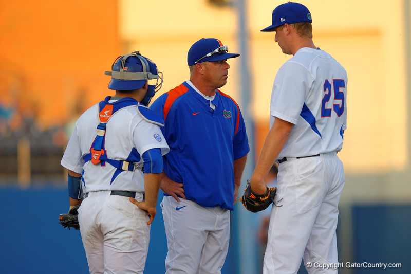 Florida Gators head coach Kevin O'Sullivan comes out to talk with pitcher Eric Hanhold during the first inning.  Florida Gators Baseball vs Florida State Seminoles.  March 17th, 2016. Gator Country photo by David Bowie.