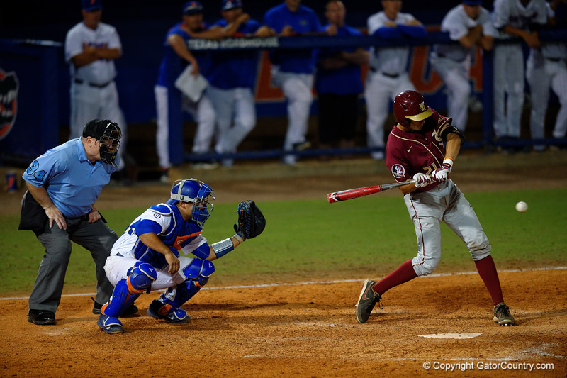 Seminoles outfielder Ben DeLuzio singles in the fifth inning.  Florida Gators Baseball vs Florida State Seminoles.  March 17th, 2016. Gator Country photo by David Bowie.