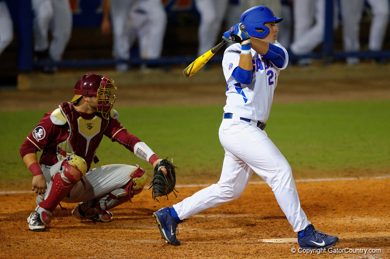 Florida Gators 1B/OF Jeremy Vasquez swings and doubles in the fifth.  Florida Gators Baseball vs Florida State Seminoles.  March 17th, 2016. Gator Country photo by David Bowie.