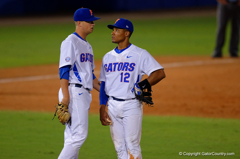 Florida Gators pitcher Kirby Snead and shortstop Richie Martin talk on the mound.  Florida Gators Baseball vs Florida State Seminoles.  March 17th, 2016. Gator Country photo by David Bowie.