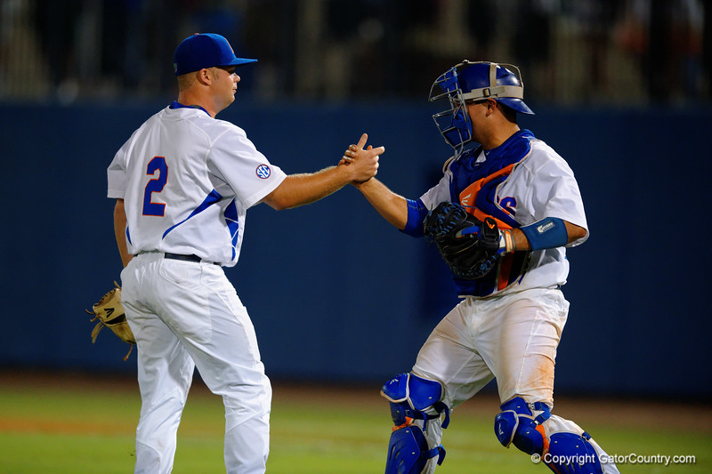 Florida Gators OF/LHP Logan Browning and Florida Gators catcher Mike Rivera celebrate the Gator win.  Florida Gators Baseball vs Florida State Seminoles.  March 17th, 2016. Gator Country photo by David Bowie.