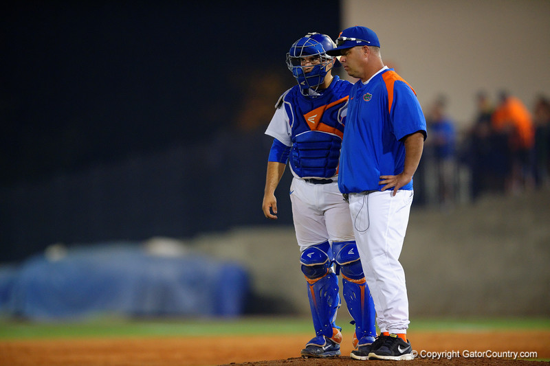 Florida Gators head coach Kevin O'Sullivan and catcher Mike Rivera stand on the mound after O'Sullvan pulled pitcher Eric Hanhold in the third.  Florida Gators Baseball vs Florida State Seminoles.  March 17th, 2016. Gator Country photo by David Bowie.