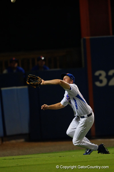 Florida Gators outfielder Ryan Larson dives for a foul ball and almost comes away with it but loses it as he hits the ground.  Florida Gators Baseball vs Florida State Seminoles.  March 17th, 2016. Gator Country photo by David Bowie.