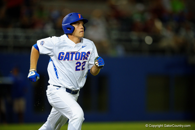 Florida Gators DH JJ Schwarz sprints down the first base line.  Florida Gators Baseball vs Florida State Seminoles.  March 17th, 2016. Gator Country photo by David Bowie.