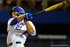 Florida Gators DH JJ Schwarz swings and drives the ball deep for a home run in the sixth.  Florida Gators Baseball vs Florida State Seminoles.  March 17th, 2016. Gator Country photo by David Bowie.