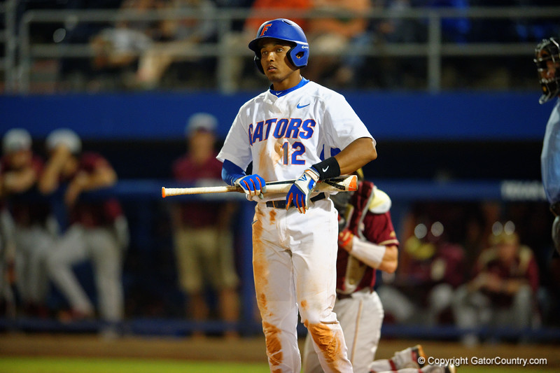 Florida Gators shortstop Richie Martin looks to third base.  Florida Gators Baseball vs Florida State Seminoles.  March 17th, 2016. Gator Country photo by David Bowie.