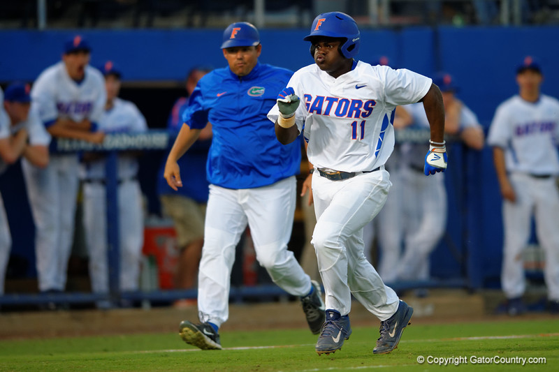 Florida Gators infielder Josh Tobias sprints down the third base line and into home to make the score 3-2 Florida.  Florida Gators Baseball vs Florida State Seminoles.  March 17th, 2016. Gator Country photo by David Bowie.