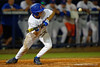 Florida Gators outfielder Ryan Larson lays down a bunt in the fourth inning.  Florida Gators Baseball vs Florida State Seminoles.  March 17th, 2016. Gator Country photo by David Bowie.