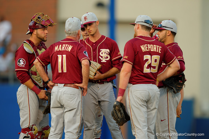 Seminoles head coach Mike Martin and the infield comes in to calm down pitcher Alec Boyd.  Florida Gators Baseball vs Florida State Seminoles.  March 17th, 2016. Gator Country photo by David Bowie.