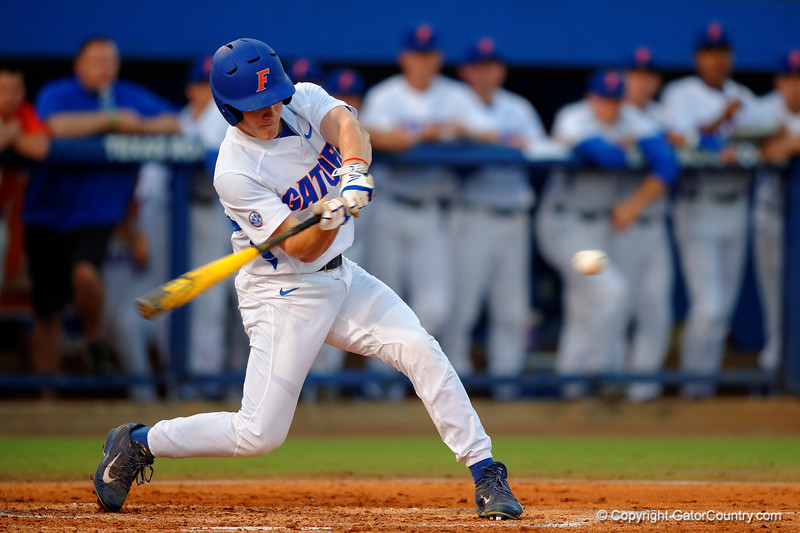 Florida Gators outfielder Harrison Bader swings and drives the ball for a triple in the first inning.  Florida Gators Baseball vs Florida State Seminoles.  March 17th, 2016. Gator Country photo by David Bowie.