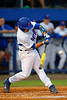 Florida Gators catcher Mike Rivera swings and singles in the first.  Florida Gators Baseball vs Florida State Seminoles.  March 17th, 2016. Gator Country photo by David Bowie.