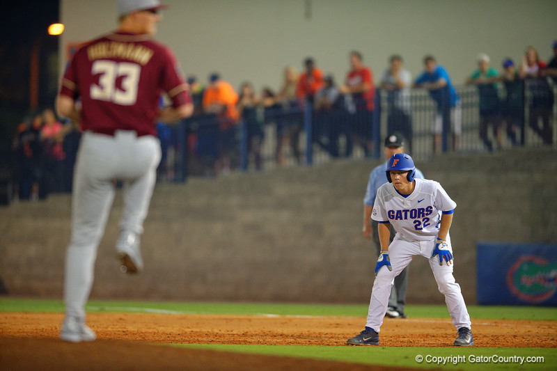 Florida Gators DH JJ Schwarz leads off from first in the third inning.  Florida Gators Baseball vs Florida State Seminoles.  March 17th, 2016. Gator Country photo by David Bowie.