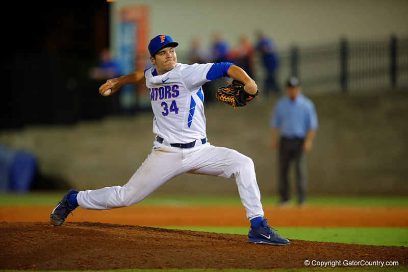 Florida Gators pitcher Brett Morales throws to the plate in the eighth inning.  Florida Gators Baseball vs Florida State Seminoles.  March 17th, 2016. Gator Country photo by David Bowie.