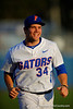 Florida Gators pitcher Brett Morales flashes a smile as he runs into the dugout.  Florida Gators Baseball vs Florida State Seminoles.  March 17th, 2016. Gator Country photo by David Bowie.