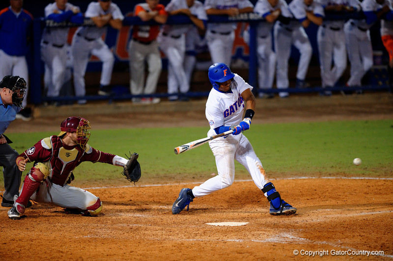 Florida Gators shortstop Richie Martin swings at a pitch in the fifth inning.  Florida Gators Baseball vs Florida State Seminoles.  March 17th, 2016. Gator Country photo by David Bowie.
