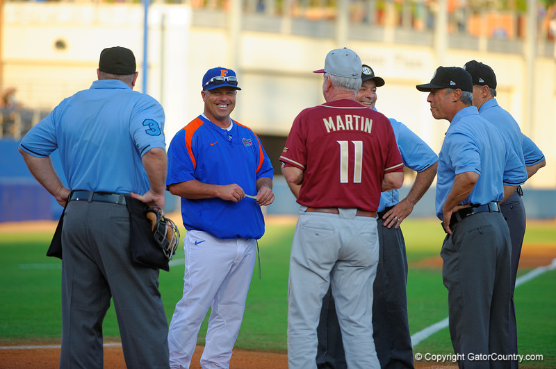 Florida Gators head coach Kevin O'Sullivan smiles as the coaches and referees gather before the first pitch.  Florida Gators Baseball vs Florida State Seminoles.  March 17th, 2016. Gator Country photo by David Bowie.