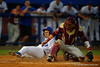Florida Gators infielder John Sternagel slides into home bringing the score 5-2 Florida in the first inning.  Florida Gators Baseball vs Florida State Seminoles.  March 17th, 2016. Gator Country photo by David Bowie.