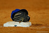Florida Gators infielder Josh Tobias's hat and glove rest on third base.  Florida Gators Baseball vs Florida State Seminoles.  March 17th, 2016. Gator Country photo by David Bowie.