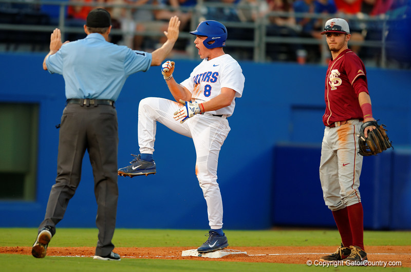 Florida Gators outfielder Harrison Bader is pumped after his triple brings in the run.  Florida Gators Baseball vs Florida State Seminoles.  March 17th, 2016. Gator Country photo by David Bowie.