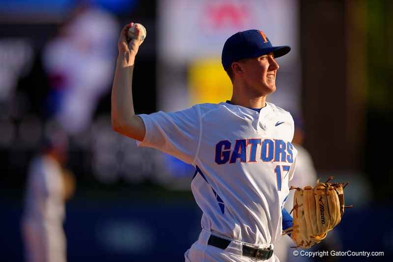 Florida Gators infielder Christian Hicks throws toward first base during infield practice prior to the start of the game.  Florida Gators Baseball vs Florida State Seminoles.  March 17th, 2016. Gator Country photo by David Bowie.