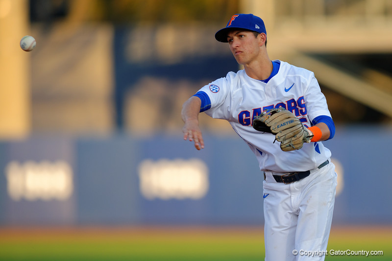 Florida Gators infielder Dalton Guthrie fields a ball and throws to first for an out in the first inning.  Florida Gators Baseball vs Florida State Seminoles.  March 17th, 2016. Gator Country photo by David Bowie.