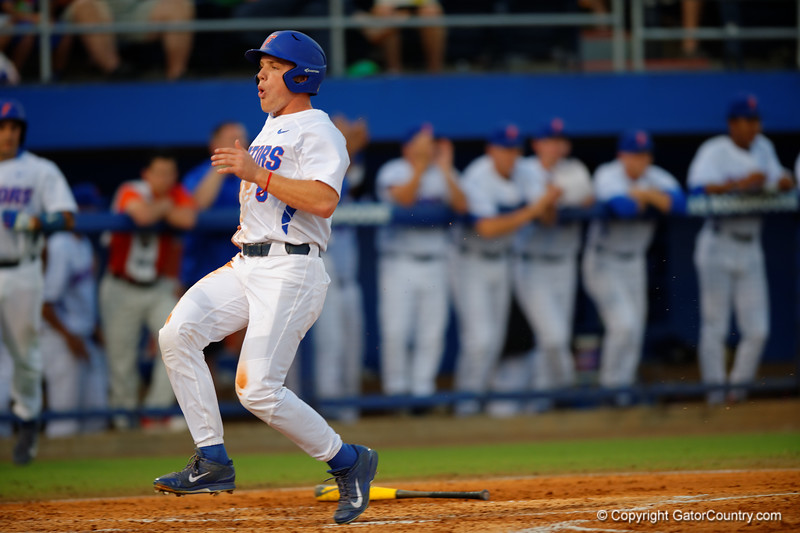 Florida Gators infielder Josh Tobias singles in the first inning bringing in Harrison Bader on third.  Florida Gators Baseball vs Florida State Seminoles.  March 17th, 2016. Gator Country photo by David Bowie.