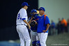 Florida Gators head coach Kevin O'Sullivan talks with Florida Gators pitcher Alex Faedo after bringing him in from the bullpen.  Florida Gators Baseball vs Florida State Seminoles.  March 17th, 2016. Gator Country photo by David Bowie.
