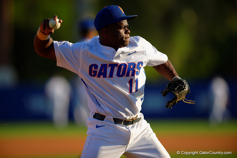 Florida Gators third baseman Josh Tobias throws toward first base during infield practice prior to the start of the game.  Florida Gators Baseball vs Florida State Seminoles.  March 17th, 2016. Gator Country photo by David Bowie.