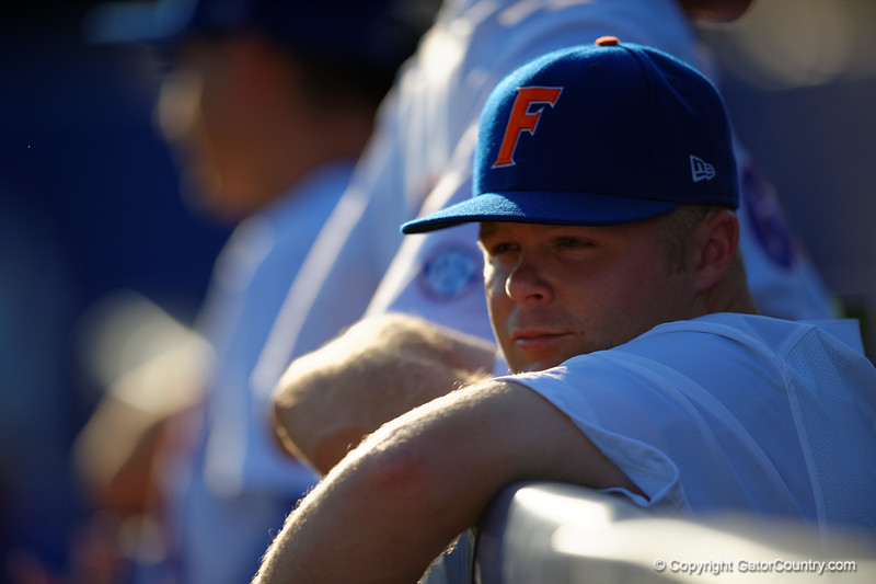 Florida Gators OF/LHP Logan Browning looks on from the dugout prior to the start of the game.  Florida Gators Baseball vs Florida State Seminoles.  March 17th, 2016. Gator Country photo by David Bowie.