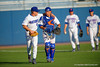 Florida Gators outfielder Harrison Bader throws his arm around catcher Mike Rivera as the two walk toward the dugout prior to the start of the game.   Florida Gators Baseball vs Florida State Seminoles.  March 17th, 2016. Gator Country photo by David Bowie.