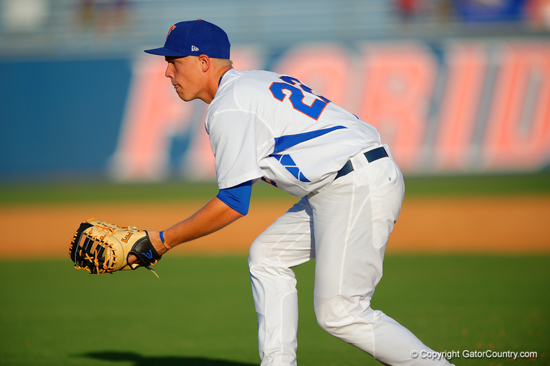 Florida Gators catcher JJ Schwarz takes infield practice prior to the start of the game.  Florida Gators Baseball vs Florida State Seminoles.  March 17th, 2016. Gator Country photo by David Bowie.