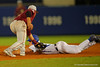 Florida Gators outfielder Harrison Bader is tagged out as he slides into second base.  Florida Gators Baseball vs Florida State Seminoles.  March 17th, 2016. Gator Country photo by David Bowie.