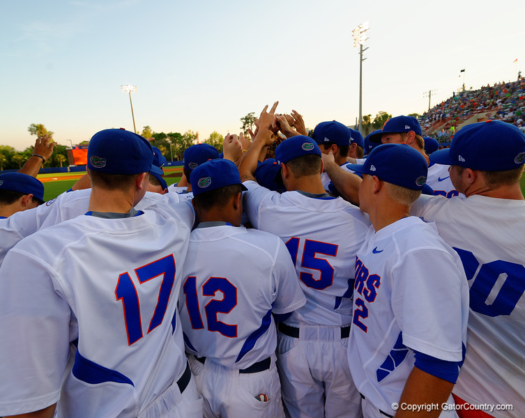 The Gators huddle together before taking the infield.  Florida Gators Baseball vs Florida State Seminoles.  March 17th, 2016. Gator Country photo by David Bowie.