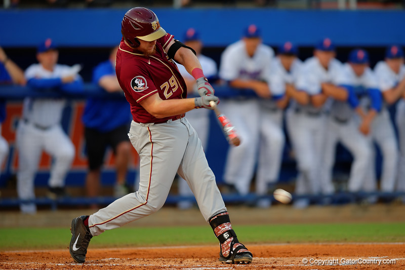 FSU infielder Quincy Nieporte singles and drives in a run in the first inning.   Florida Gators Baseball vs Florida State Seminoles.  March 17th, 2016. Gator Country photo by David Bowie.