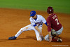 Florida Gators infielder Dalton Guthrie's tag on a sliding Seminole's outifielder Josh Delph is late.  Florida Gators Baseball vs Florida State Seminoles.  March 17th, 2016. Gator Country photo by David Bowie.