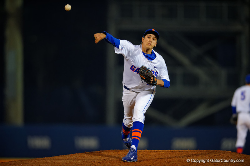 Florida Gators pitcher Alex Faedo delivers a ball to the plate during the seventh inning.  Florida Gators vs Rhode Island Rays.  February 13th, 2015. Gator Country photo by David Bowie.