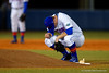Florida Gators pitcher Logan Shore crouches down behind before taking the mound in the second inning.  Florida Gators vs Rhode Island Rays.  February 13th, 2015. Gator Country photo by David Bowie.
