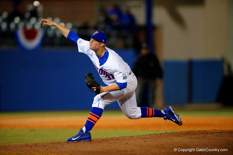 Florida Gators pitcher Logan Shore delivers a pitch during the first inning.  Florida Gators vs Rhode Island Rays.  February 13th, 2015. Gator Country photo by David Bowie.