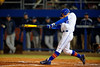 Florida Gators catcher JJ Schwarz drives a ball into the outfield during the fourth inning.  Florida Gators vs Rhode Island Rays.  February 13th, 2015. Gator Country photo by David Bowie.