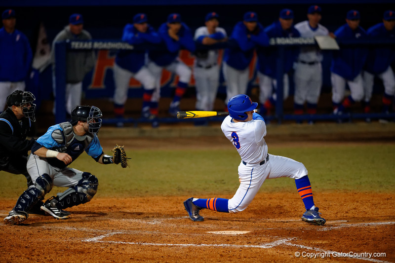 Florida Gators outfielder Harrison Bader crushes a ball over the left field wall for his first home run of the season.  Florida Gators vs Rhode Island Rays.  February 13th, 2015. Gator Country photo by David Bowie.