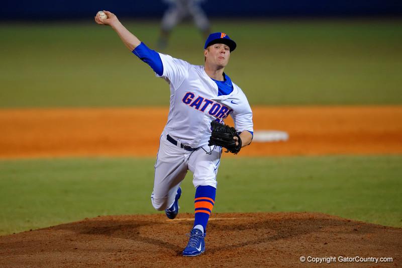Florida Gators pitcher Logan Shore throwing toward home.  Florida Gators vs Rhode Island Rays.  February 13th, 2015. Gator Country photo by David Bowie.
