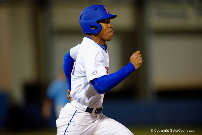 Florida Gators outfielder Buddy Reed drives a ball for a base hit in the first inning.  Florida Gators vs Rhode Island Rays.  February 13th, 2015. Gator Country photo by David Bowie.