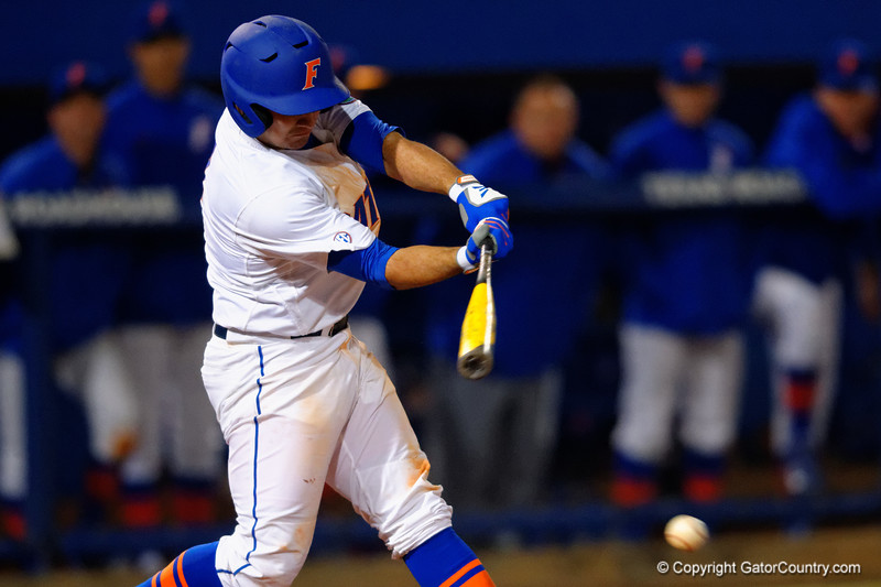 Florida Gators catcher Mike Rivera swings away at a pitch.  Florida Gators vs Rhode Island Rays.  February 13th, 2015. Gator Country photo by David Bowie.